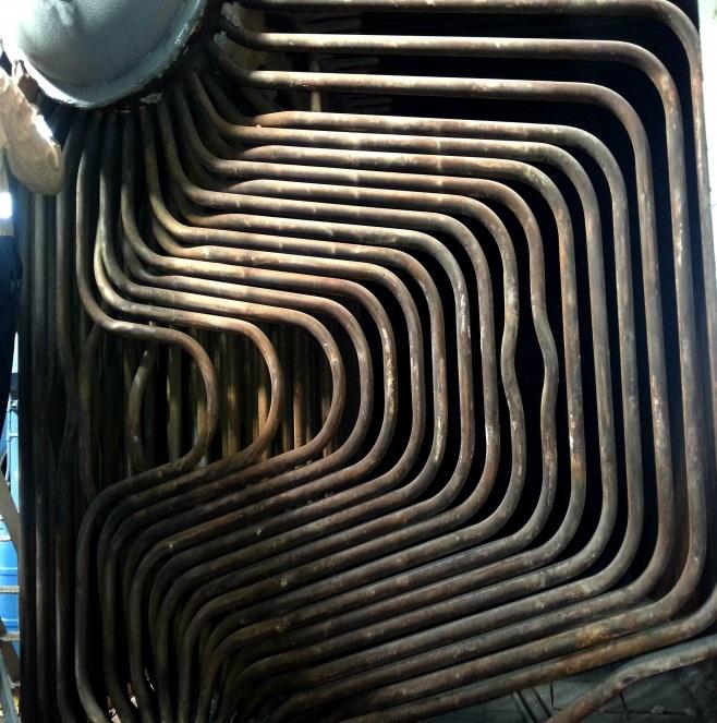 Tube bending boiler end-wall